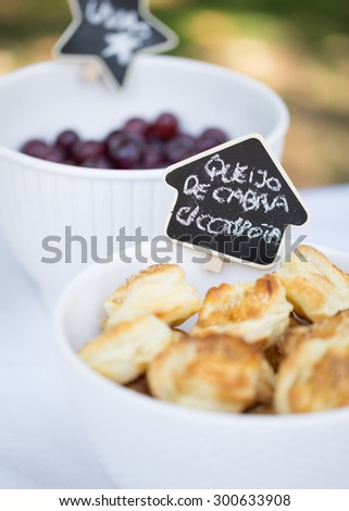 Outdoor Buffet, Goat Cheese with Jam, Mini Pies - stock photo