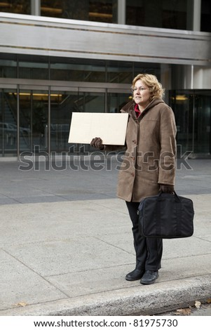 Outdoor business woman with blank sign vertical - stock photo