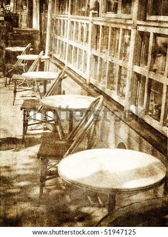 Outdoor cafe.  Photo in vintage image style. - stock photo