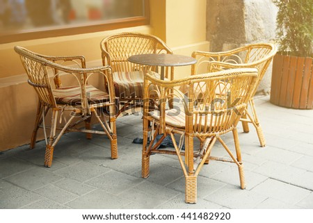 Outdoor cafe table with chairs on a sunny  day