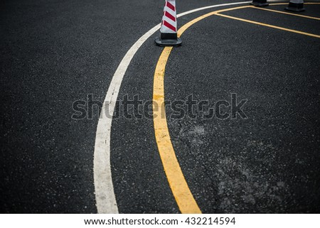 outdoor car parking lot with traffic cone - stock photo