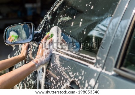 Outdoor car wash with sponge - stock photo