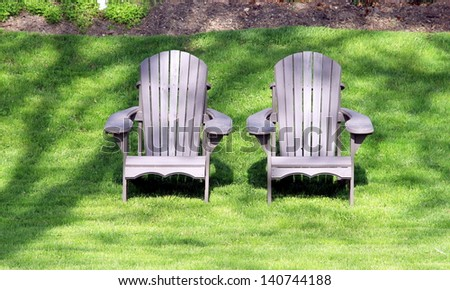 Outdoor chairs in a garden - stock photo