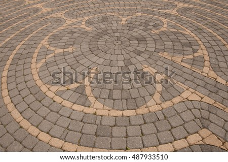 Outdoor Chartres style prayer labyrinth made of gray and tan bricks