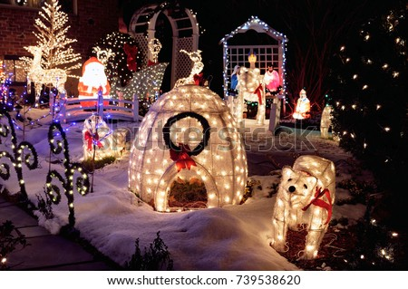 Outdoor christmas decoration lights lighted ornaments stock photo outdoor christmas decoration lights and lighted ornaments glowing in the night house yard covered aloadofball Image collections