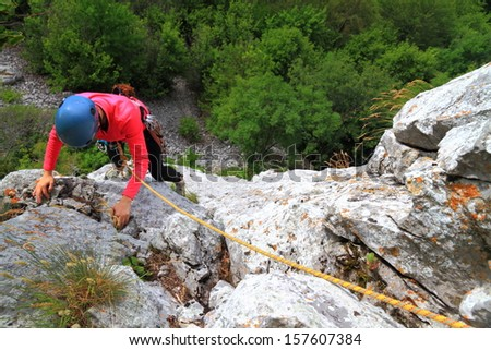 Outdoor climbing on limestone route  - stock photo