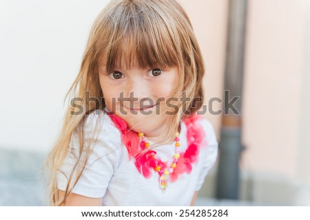 Outdoor close up portrait of a cute little girl - stock photo