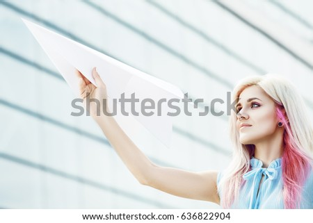 Outdoor full body portrait young beautiful stock photo 636822907 outdoor close up portrait of young beautiful girl holding big white paper airplane model with voltagebd Images