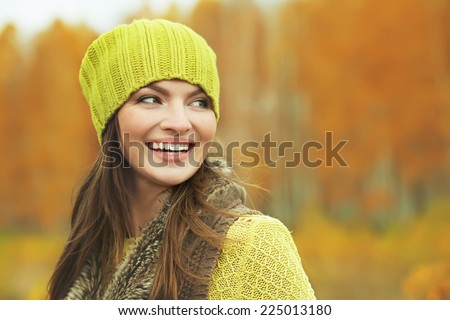 outdoor closeup portrait of a beautiful brunette middle aged woman - stock photo