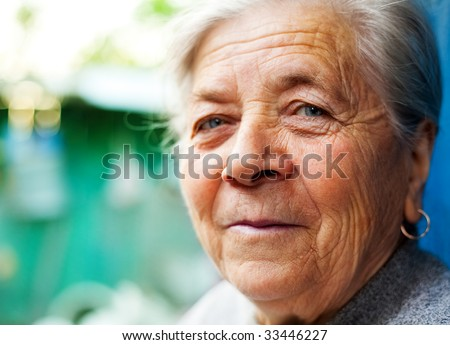 Outdoor Closeup Portrait of Smiling Old Senior Lady - stock photo