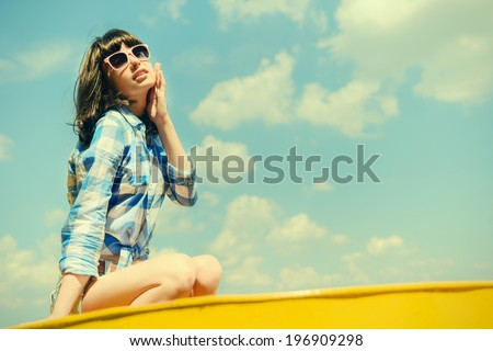 Outdoor closeup summer portrait of pretty young brunette woman in glasses - stock photo