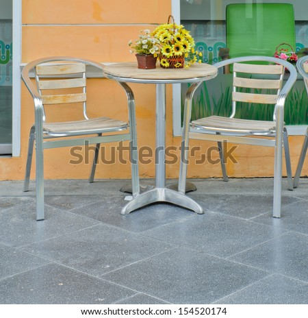 Outdoor coffee table and chairs - stock photo