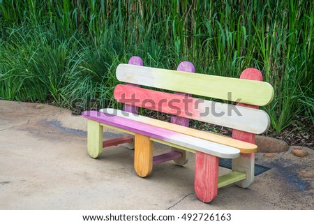 Outdoor colorful chair in garden