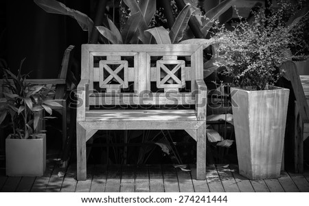 outdoor cottage bench in black and white - stock photo