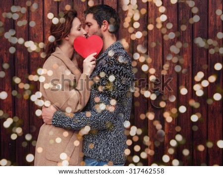 outdoor  couple holding heart in february - stock photo