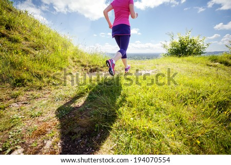 Outdoor cross-country running in early sunrise concept for exercising, fitness and healthy lifestyle - stock photo