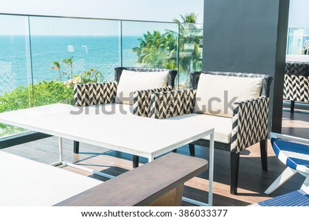 Outdoor deck with modern chair and table - Vintage filter