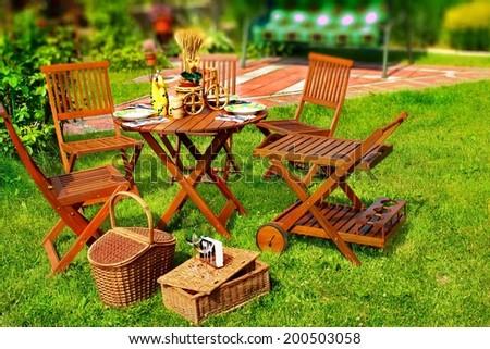 Outdoor Dining Scene in Backyard. Tilt-shift effect. - stock photo