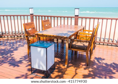 Outdoor empty chair and table on the beach decoration in restaurant