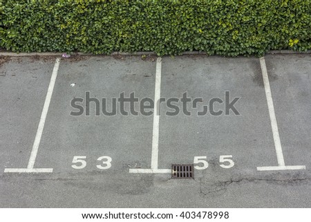 Outdoor empty space at car parking lot - stock photo
