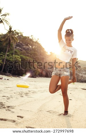 Outdoor fashion lifestyle portrait of young happy stylish sexy woman posing in summer on the beach near blue color water having fun outdoor on vacation - stock photo
