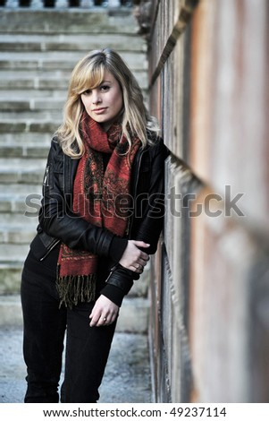 Outdoor Fashion Portrait Leaning Against Wall