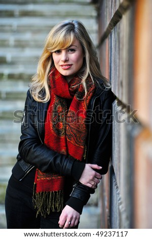 Outdoor Fashion Portrait Leaning Against Wall - stock photo