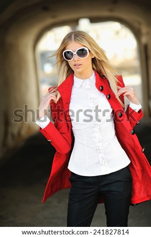 Outdoor fashion portrait of beautiful blonde woman wearing sunglasses - stock photo