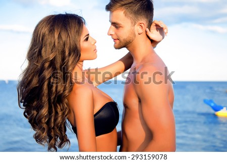 Outdoor fashion portrait of happy smiling couple love having fun together end enjoy their love and romantic date.Happy coupe enjoy their trip,together,summer love,people in love,summer love,accessory - stock photo