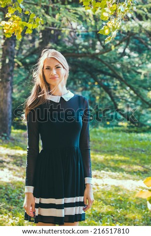 Outdoor Fashion Portrait of Pretty Hipster Vintage Girl Woman in the forest