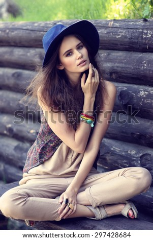 Outdoor fashion portrait of young beautiful woman. - stock photo