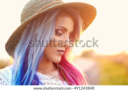 Outdoor fashion portrait of young beautiful woman, boho chic style