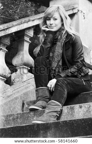 Outdoor Fashion Portrait Of Young Woman Sitting On Steps - stock photo