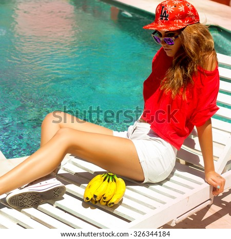 Outdoor fashion portrait summer beach style of young beautiful blonde woman fresh face smiling on the beach of tropic island having fun on vacation in blue dress and sunglasses - stock photo