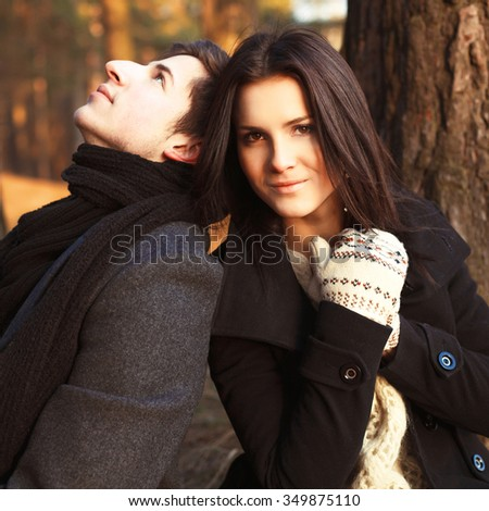 Outdoor fashion sexy couple in love having fun together in winter forest  - stock photo