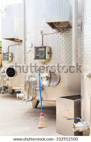 Outdoor fermentation tanks for wine. - stock photo