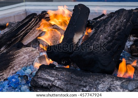 Outdoor fireplace with charcoal and firewood