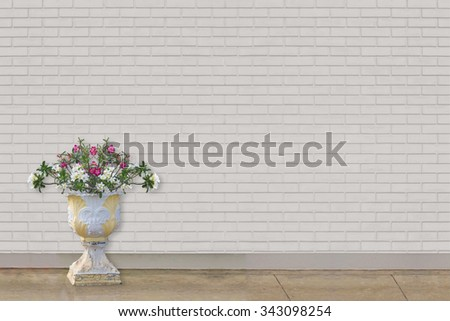 outdoor flower vase at  white brick wall  - stock photo