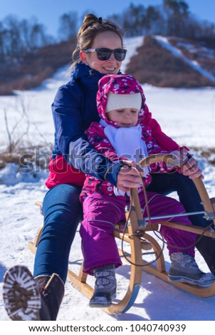 outdoor fun for family christmas vacation in a beautiful sunny winter day mummy is - Christmas Vacation Sled