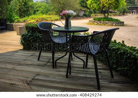 Outdoor furniture of tables and chairs with flowerpot