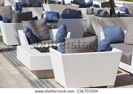 outdoor furniture rattan armchairs and table on terrace  - stock photo