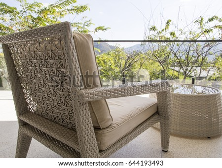 Outdoor Furniture Wicker Chair With View At Terrace