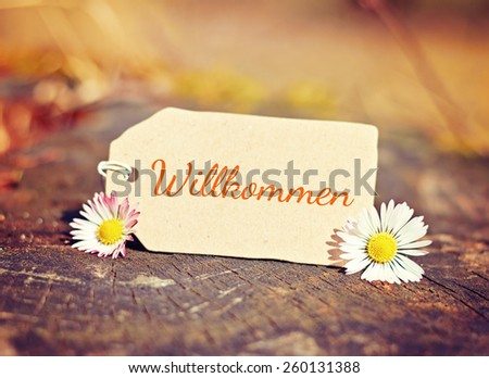 outdoor greeting card with text - german for welcome - stock photo