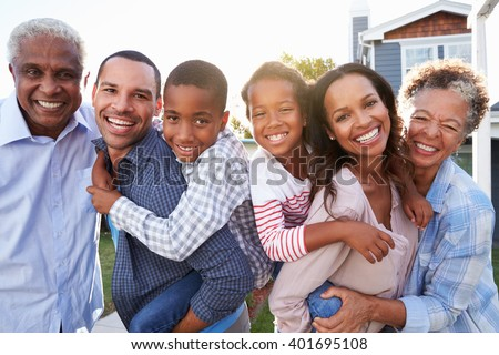 Outdoor group portrait of black multi generation family - stock photo
