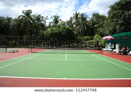 Outdoor  hard court tennis against blue sky - stock photo