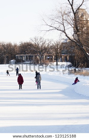 Outdoor Ice Skating in the Park - stock photo