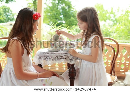 Outdoor image of girls with tea - stock photo