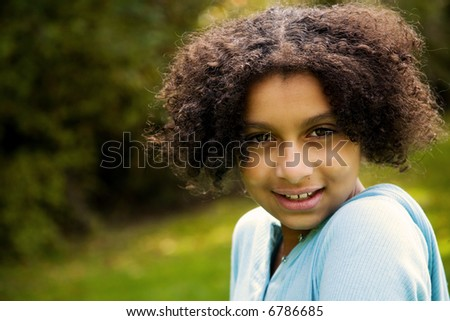 outdoor image of this pretty biracial girl - stock photo