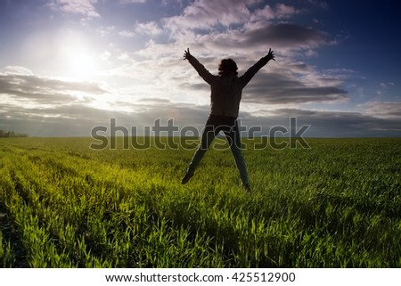 outdoor jump on the sunset background - stock photo