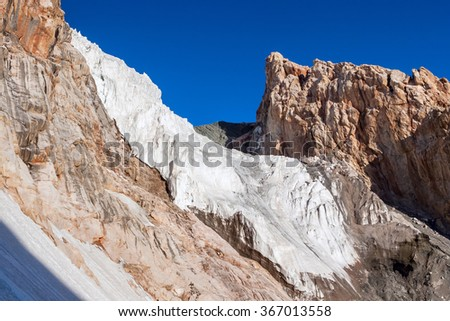 Outdoor landscape Fann Mountains, Pamir. Mountain ridge and the glacier (icefall) - stock photo